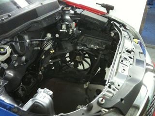 An image a car with the bonnet open.