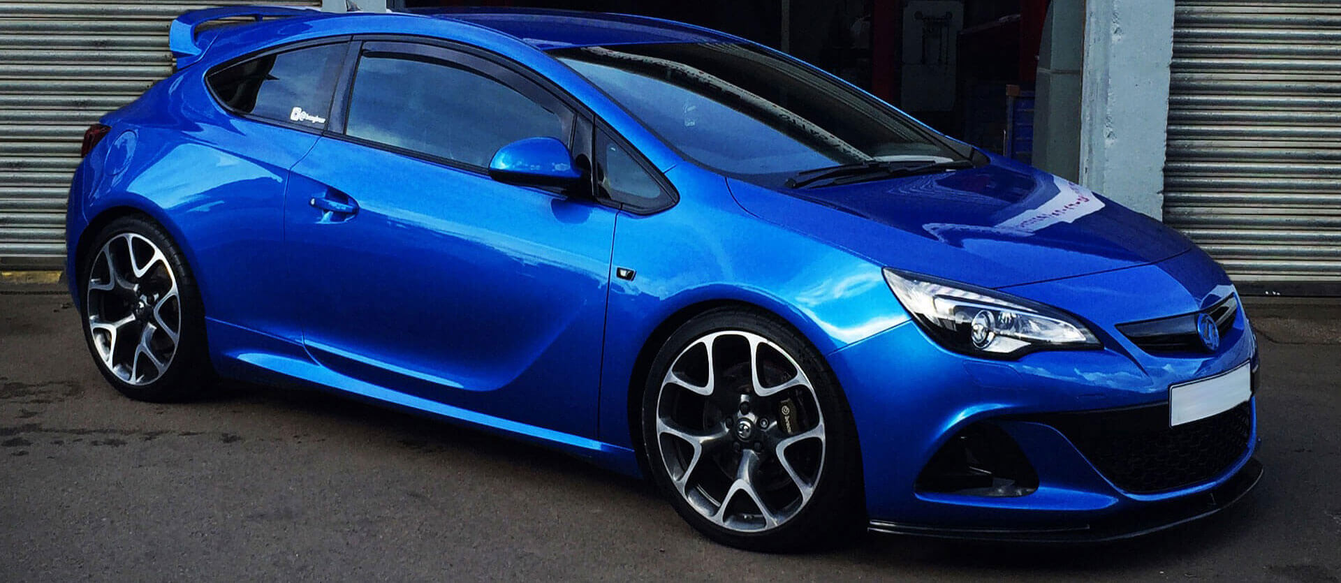 An image of a blue car outside the Griffin Autos car garage.